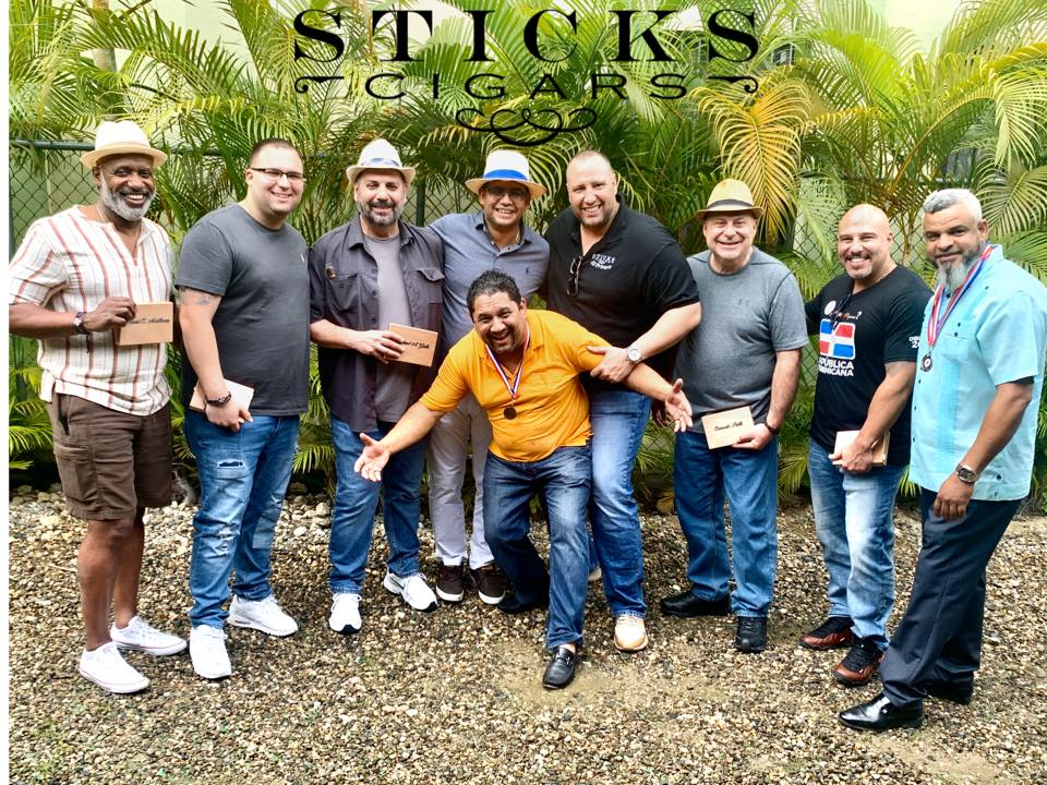 sticks cigars customers posing rahway nj
